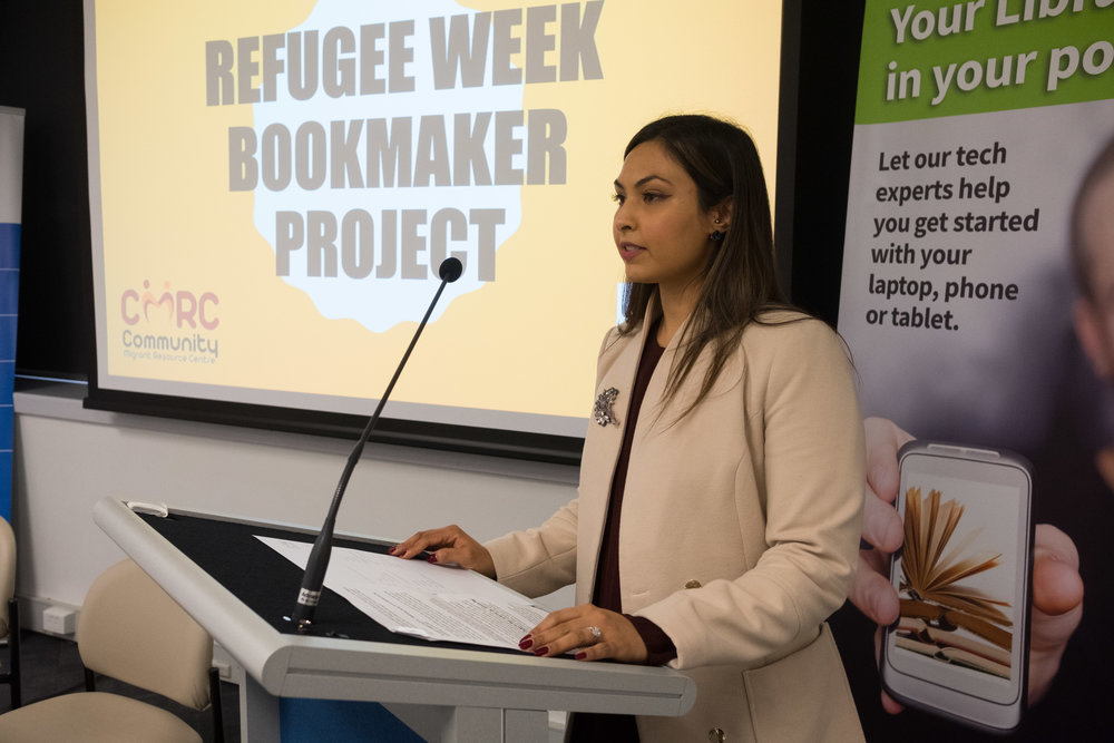 Michelle Aneli introduces the Refugee Bookmarker project to the audience