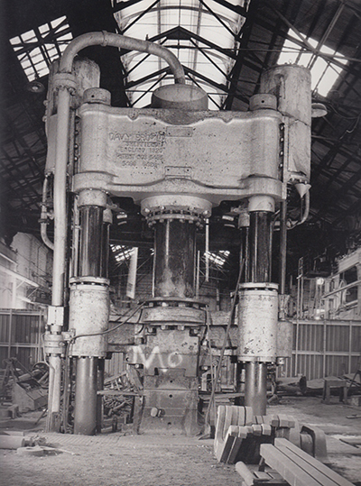 The Davy Press, a 1500 ton steam press, forged crankshafts and connecting rods for locomotives and heavy forging work. Image taken from Railways, Relics and Romance. Photograph by Henry Moore.