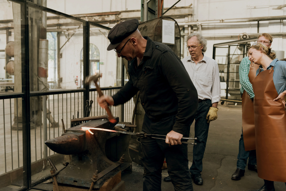 Guido demonstrating blacksmithing at Eveleigh Works course in Redfern Sydney