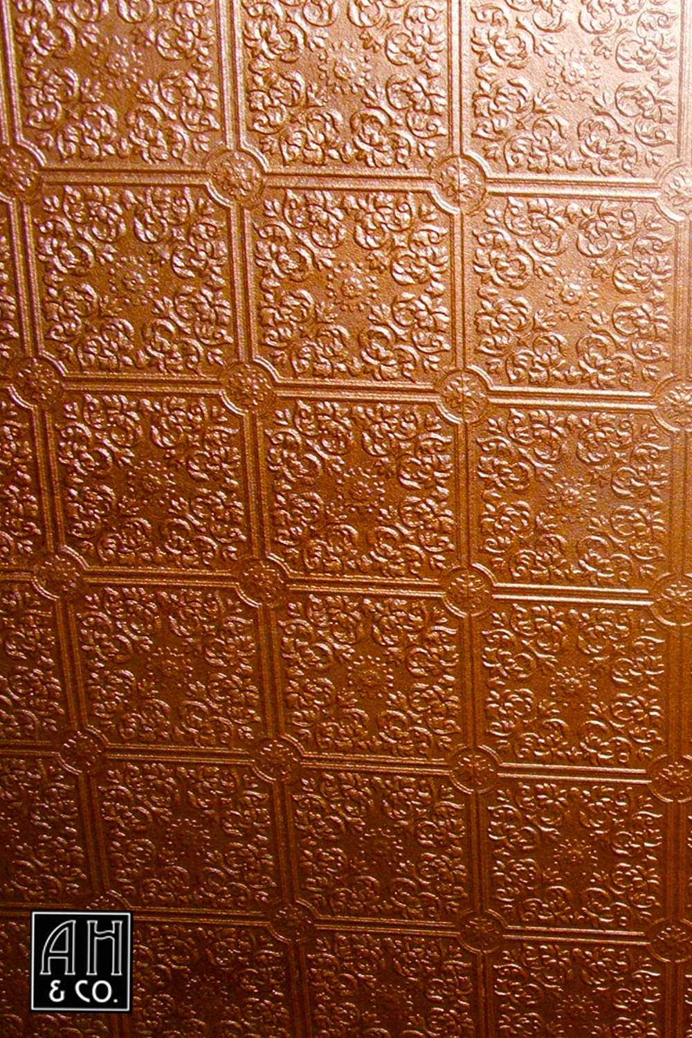 Ceiling finishes ah co decorative artisans detail paintable tile pattern paper in a faux finished antique metallic copper dailygadgetfo Image collections