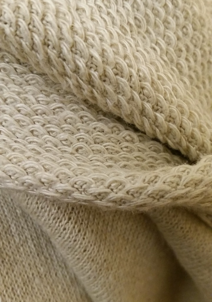 Closeup of 100% hemp knit-like fabric -- face and reverse side.