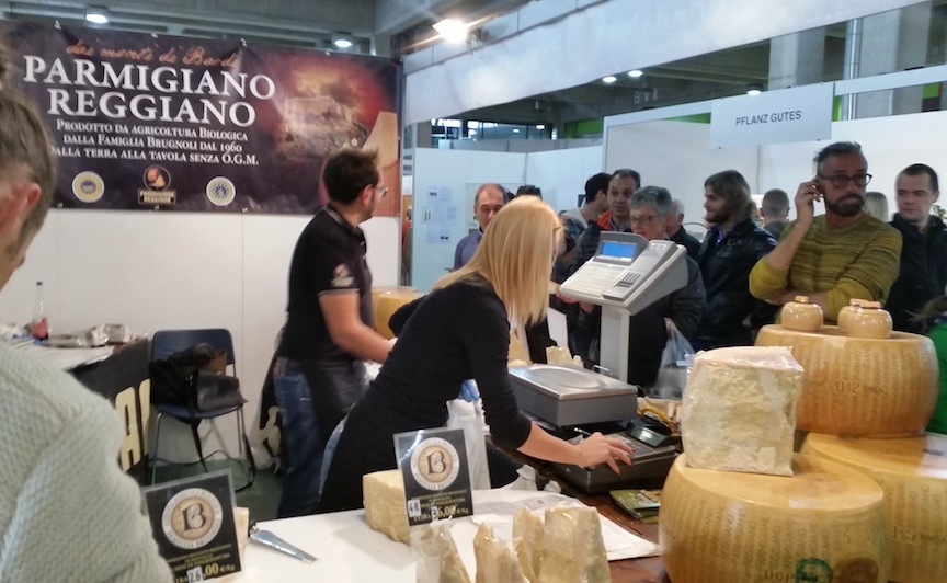 "Buying Parmesan cheese from a cheese factory located in the Italian town, ""Parma."" Aha, it finally makes sense."