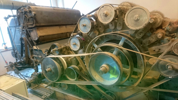 A close up of the carding machine's inner-workings.