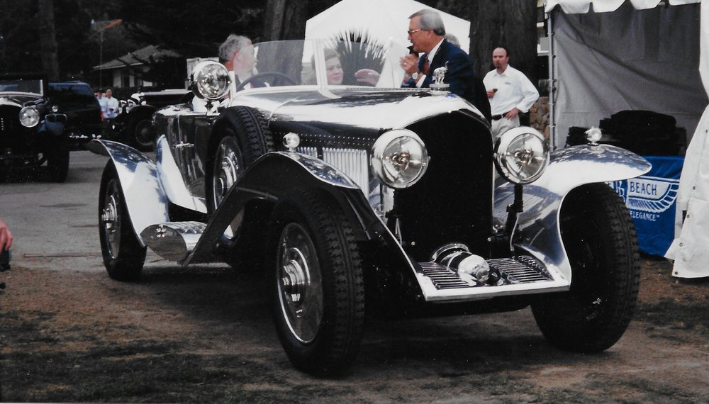 Chairman Glenn Mounger welcoming Peter and Paul at the 2001 Pebble Beach Concours d'Elegance in our 1927 Bentley 6 1/2 Litre Barker Boattail, which was originally delivered to the Maharaja of Bhavnagar.
