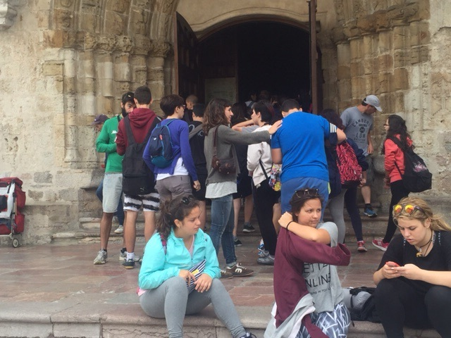 Bored students on tour of Llanes Cathedral