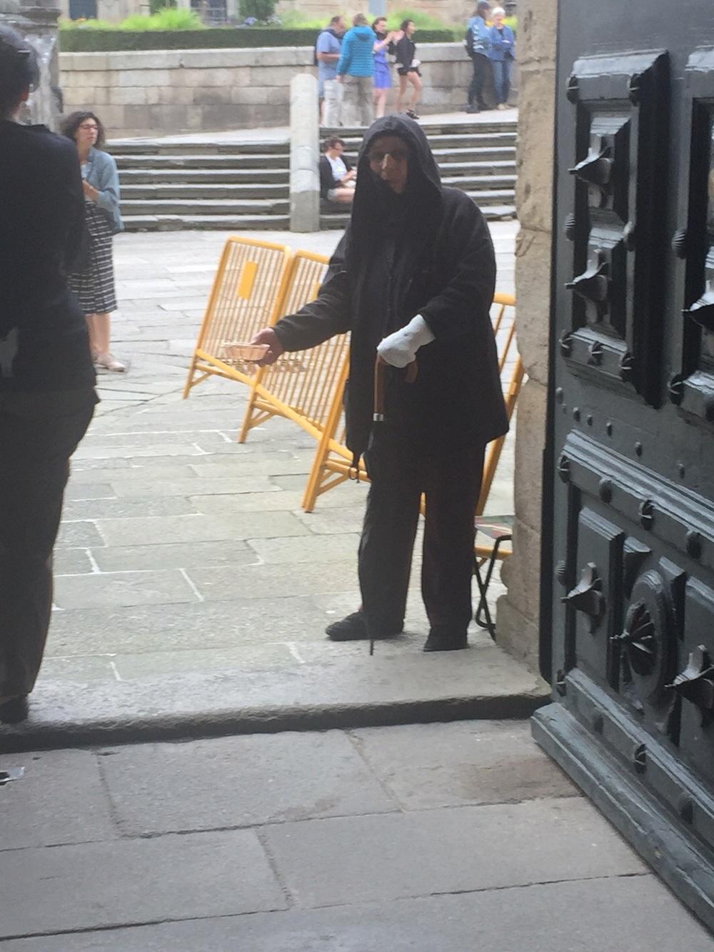 Begger at the door after Mass