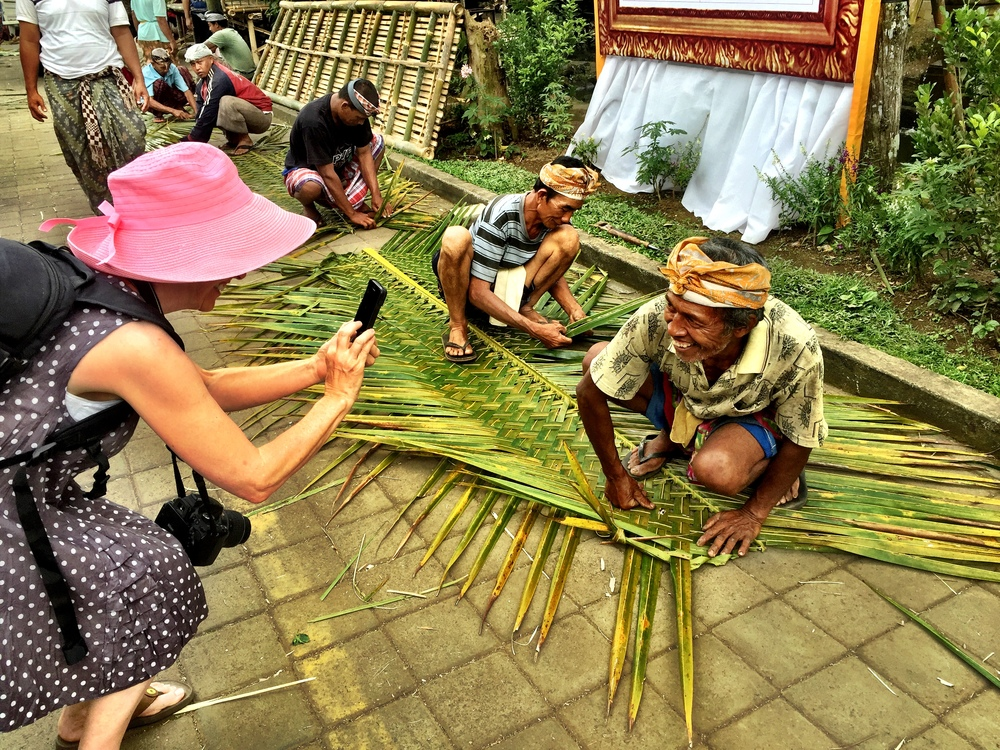 My mom taking pictures of the local artisans, weaving bamboo.