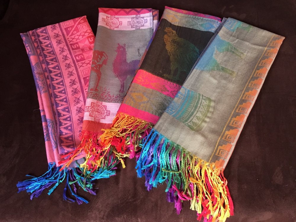 I love the subtle rainbow of colors in these super-soft alpaca scarves from an artisan market in Peru. They'd complement almost any outfit!