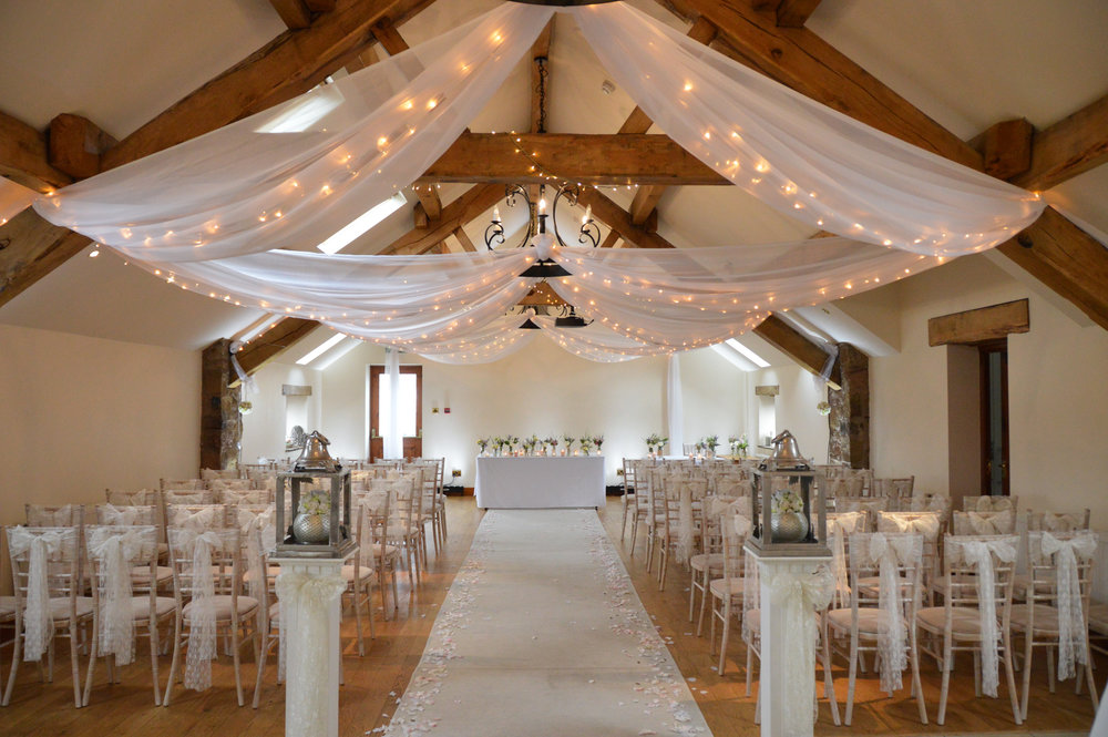 Fairy lights around the oak beams and drapes