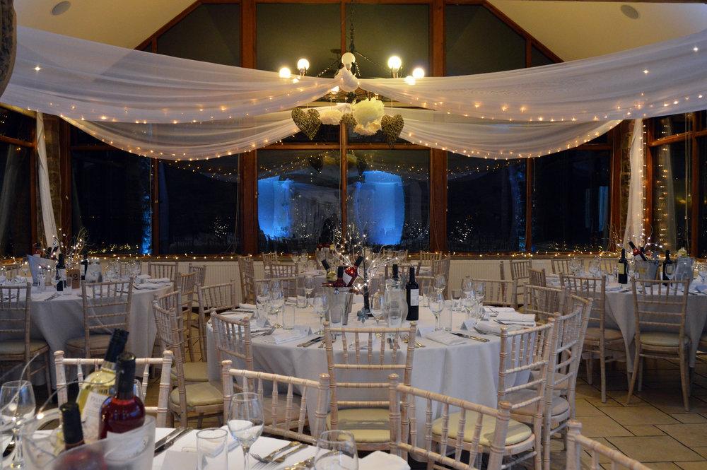 Fairy lights around the conservatory windowsill and drapes