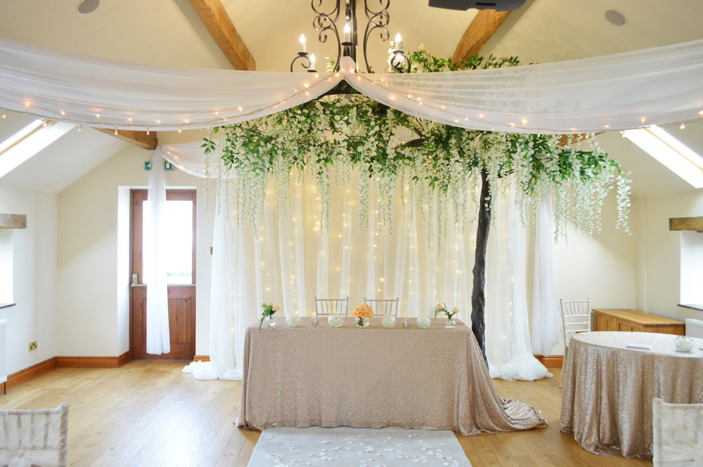 Fairy light backdrop, sequin registrar table cloth and wisteria hanging tree
