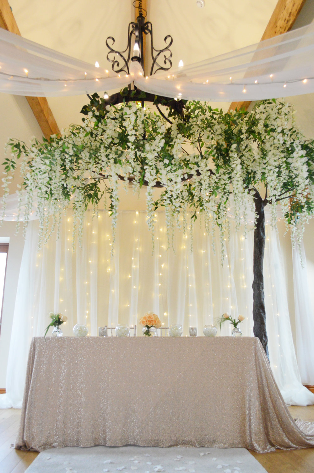 Fairy light backdrop, registar sequin table cloth and wisteria hanging tree
