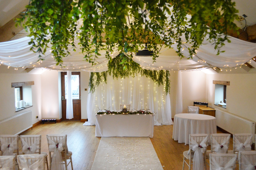 Greenery on chandelier and fairy light backdrop
