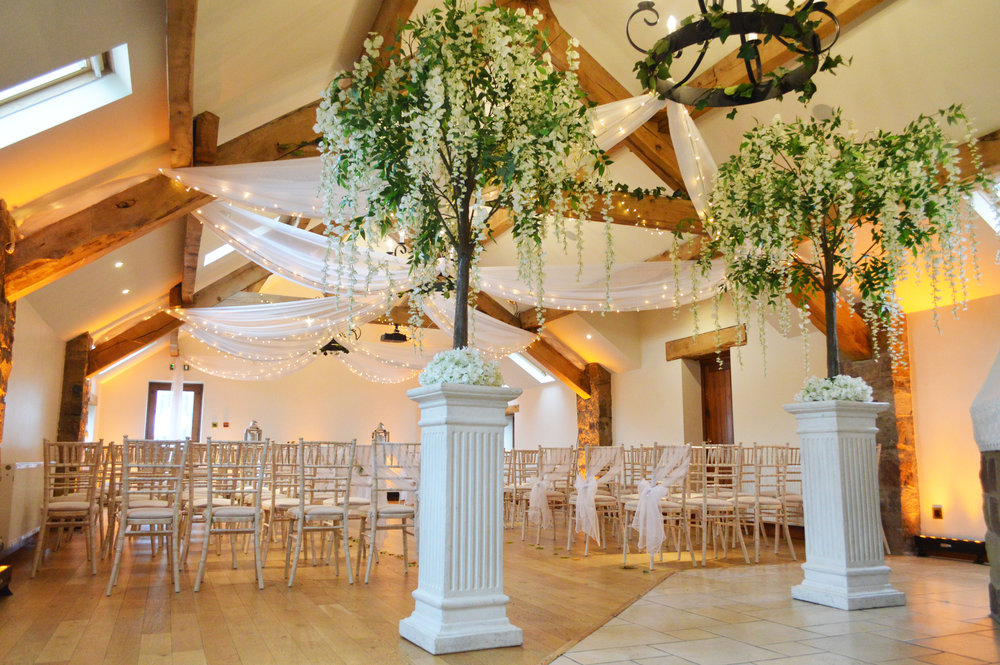 Wisteria trees on white pillars