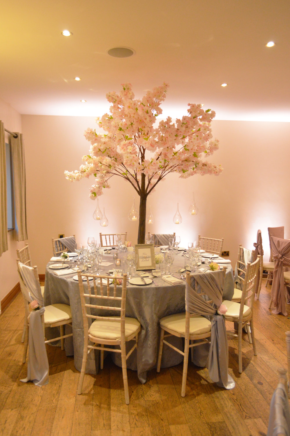 Pink blossom tree with grey table cloth