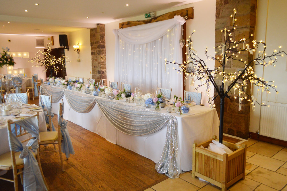 Fairy light trees and top table sequin drape