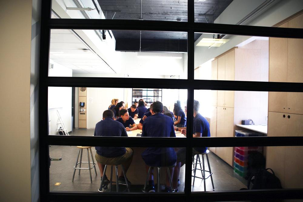 Students seen from behind one of the 'garage doors' which make the Schad Design/Tech Lab an even more flexible space, depending on activity and class size.