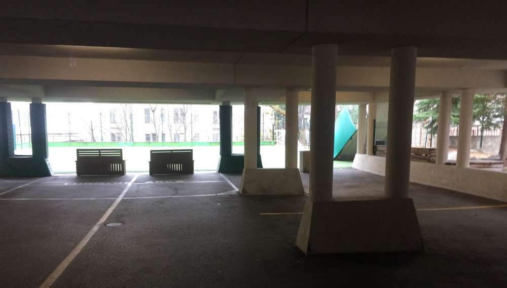 Pre-2016 parking garage under the gym. It claimed the sides of more than a few fine cars.