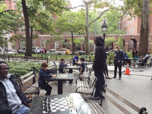 This corner of Washington Square features chess tables where masters &  novices gather to play every day (some for money, some for sport). Child prodigy Bobby Fischer, director Stanley Kubrick, & many others played these tables in their youth.