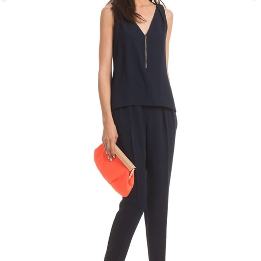"""Versatile jumpsuit for all occasions. Loved it!"" - TRINA TURKV-NECK ZIP JUMPSUITValued at $368"
