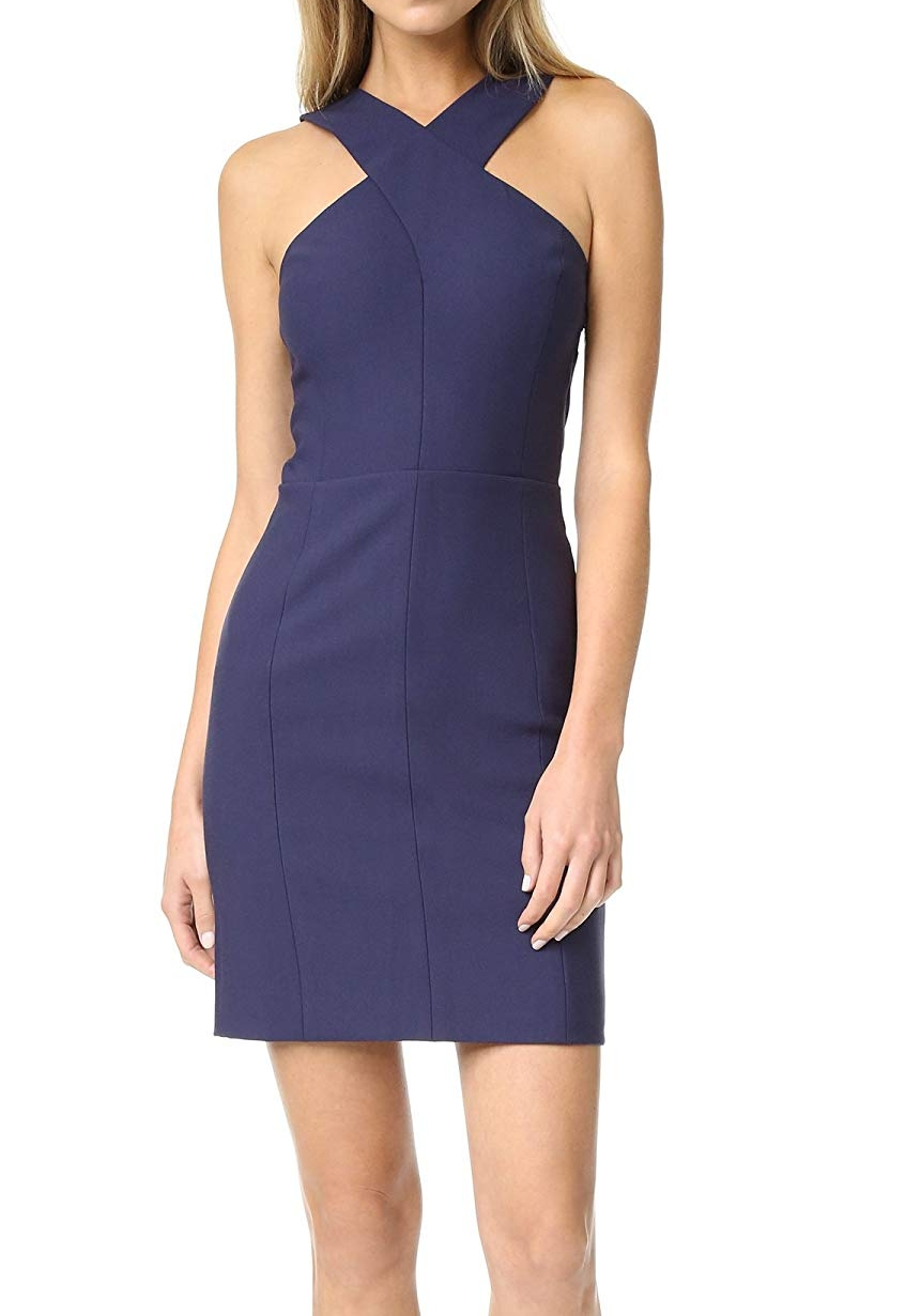 """This dress is so flattering on the body! Loved it!"" - ELIZABETH & JAMESCROSSOVER SHEATH DRESSValued at $395"