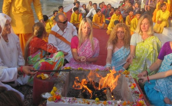 Yagna - a fire ceremony to purify body, mind and soul in Rishikesh by the river ganga