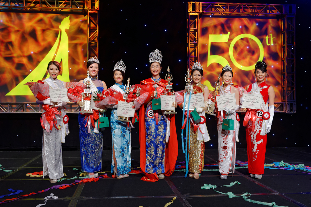 From left to right: Miss Photogenic Coco Pang, Third Princess Vivian Tisi, First Princess Erika Liu, Queen Alice Wong, Second Princess Clarissa Liu, Fourth Princess Tiffany Chi, and Miss Friendship Tracy Jung.