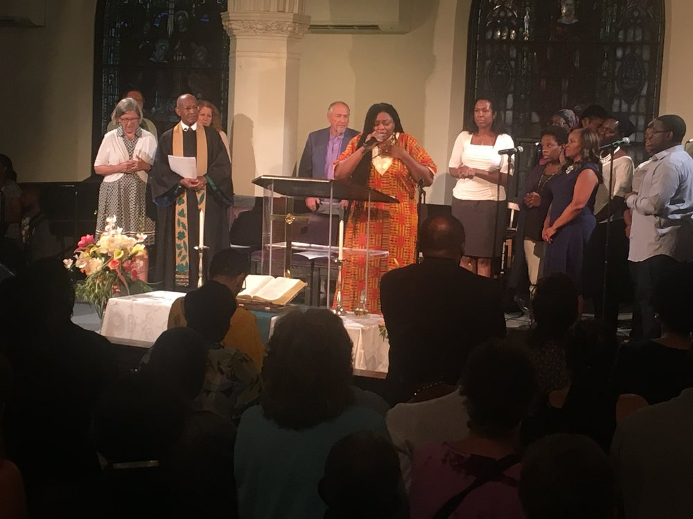 Boston Revival Yara Allen leading the choir and audience in song