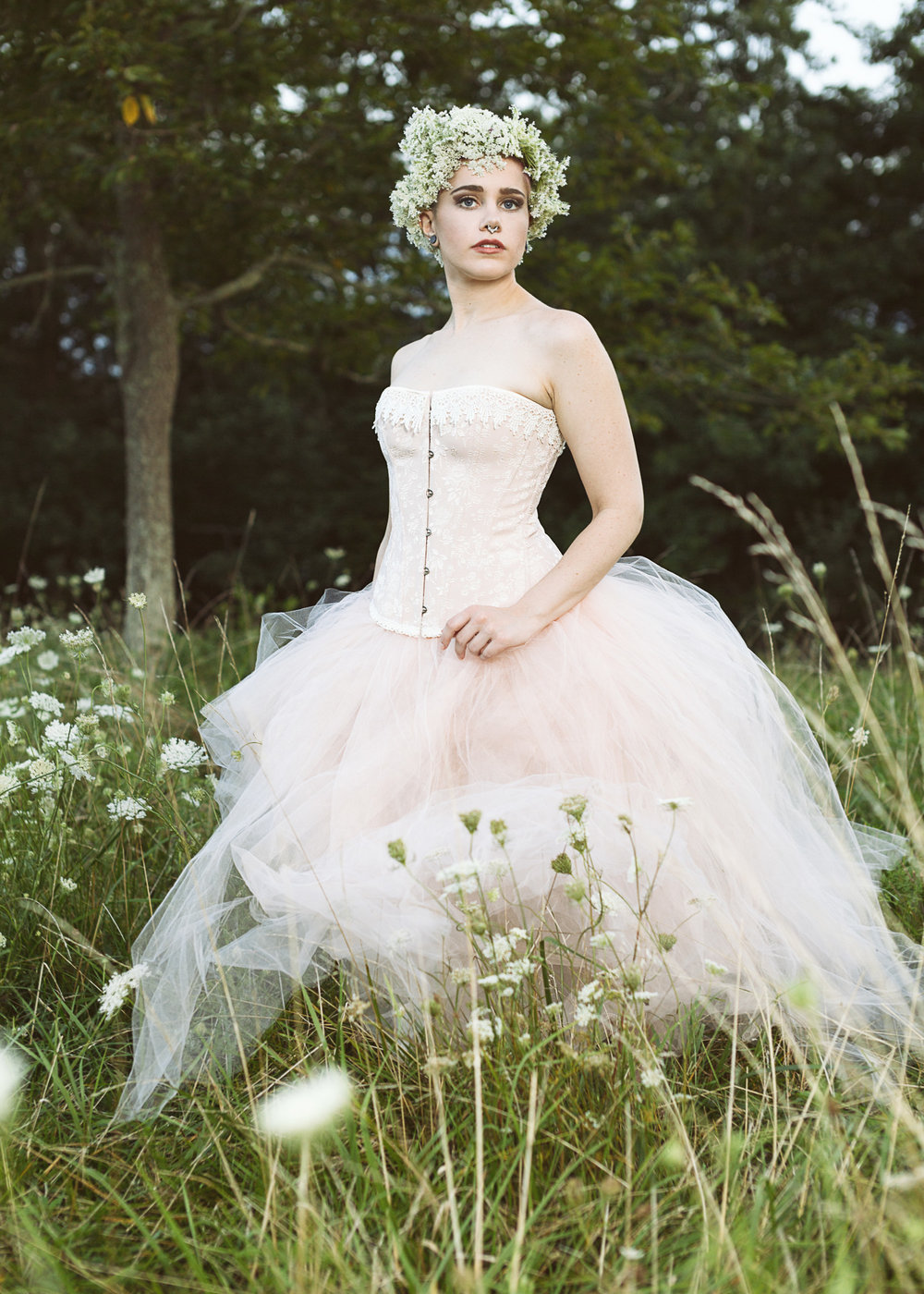 Hannah's tulle gown looks beautiful in the meadow