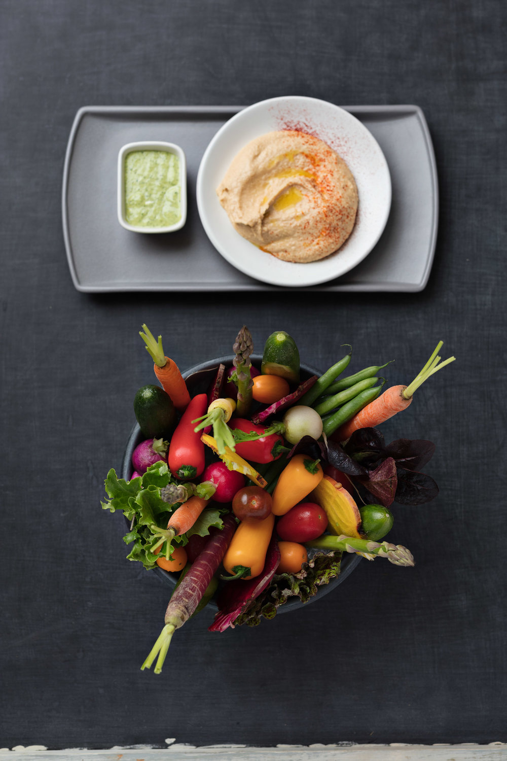 Heirloom vegetables with olive oil hummus