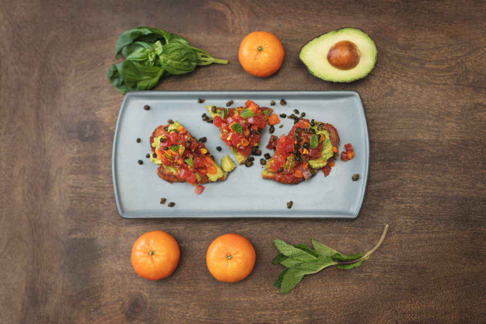 Italian bruschetta with avocado and mint