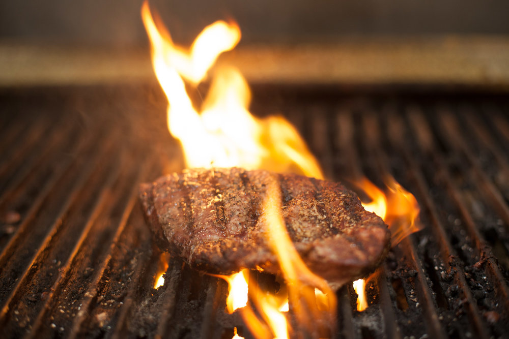 Flame grilled salted New York Strip steak