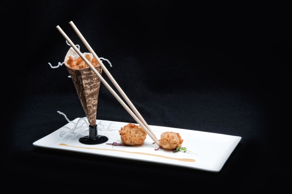 Japanese style coconut shrimp with chopsticks on a white plate