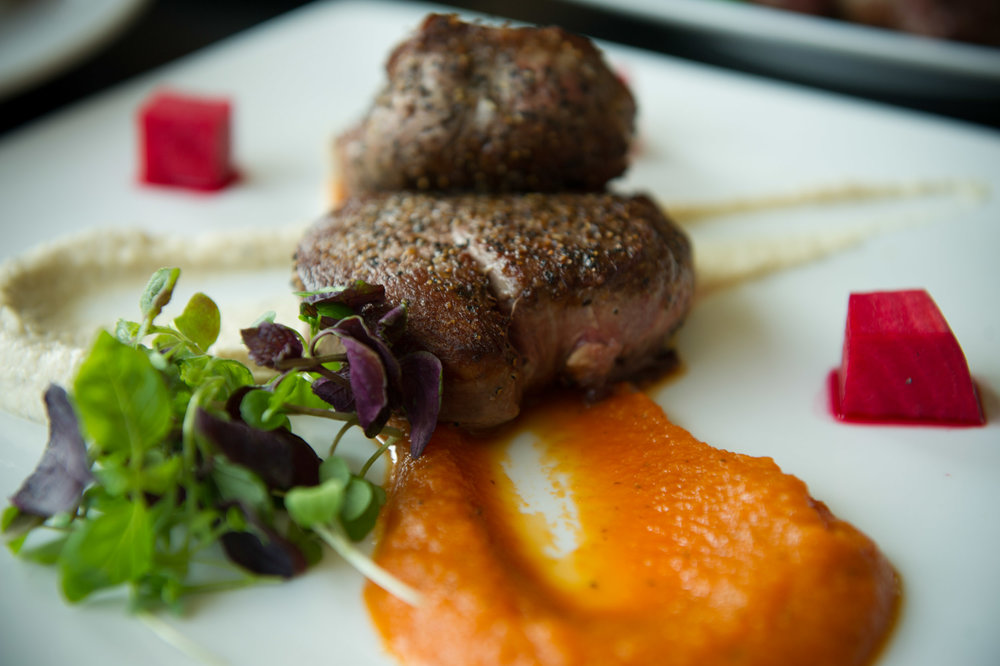 Fire roasted ribeye steak with carrot puree, parsnip puree, microgreen salad, and cubed beets