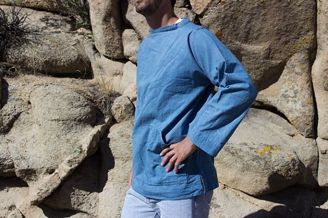 "This is a work smock in large, dyed with indigo. We developed the pattern slowly over the past couple of years, modeled after a traditional English fisherman's ""slop"". We have three sizes and colors available on our website. All handsewn in Massachusetts and dyed in LA! If you'd like one by Christmas, order by Tuesday the 17th."