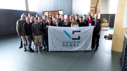 Founder and Senior Manager Heinrich Sagel with new apprentices and staff responsible for the company