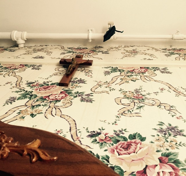 Above our bed, Crucifix + protection sachet of herbs and crystals.