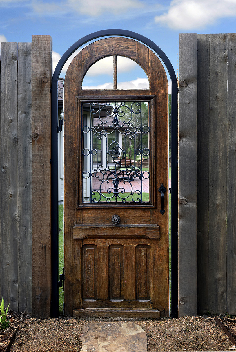 The Center Of The Gate Has A Very Old Grate, A Beautiful Piece Of Ironwork  That Allows The Visitor To Peak Into The Trellis Courtyard And Enjoy The  View.