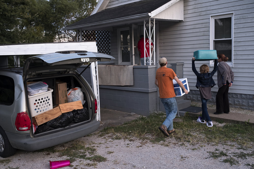 After living in a hotel and a motel for over a year and a half, the Knoxes finally found a rental home to move into. The Knoxes unloaded a van-full of their stuff as they moved into the home.
