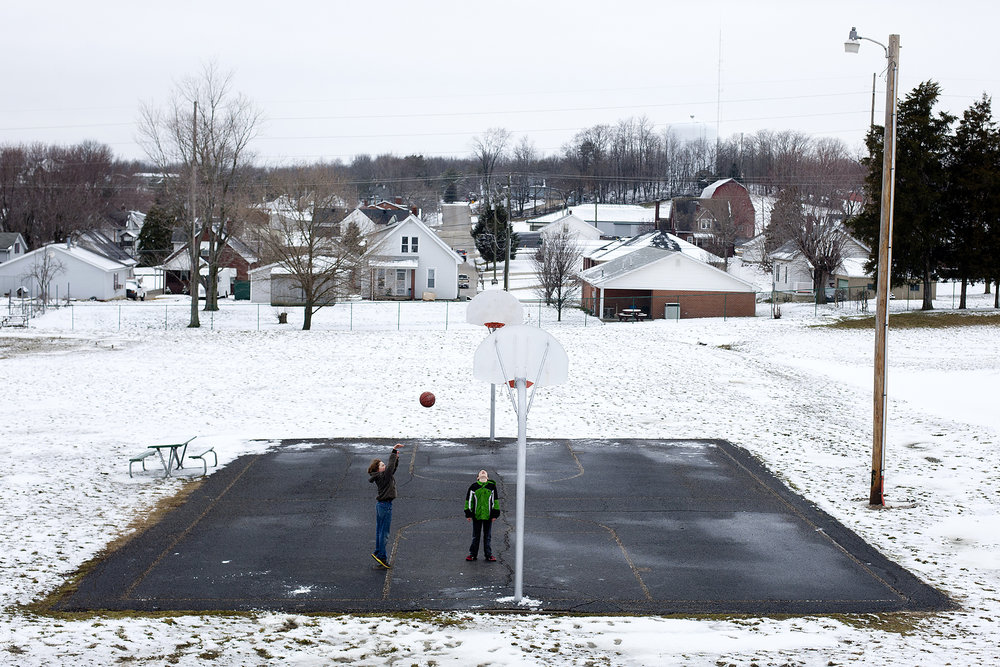 "Andrew Franklin, left, and Quentin Lechner, both 11, shot hoops and played Around the World after school at Gutzweiler Park near their Jasper homes. The two said they weren't bothered by the snow or the cold. ""Since we are moving around, we are staying warm,"" Andrew said. ""Yeah, kinetic energy,"" Quentin added."