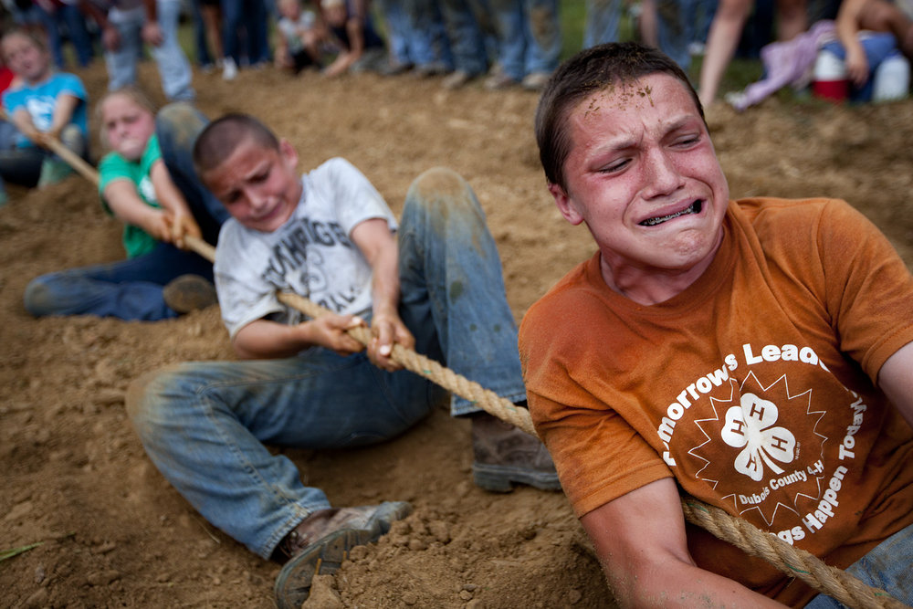 Prestyn Balsmeyer of Huntingburg, 14, right, and his brother Chanler, 11, pulled with all their strength during the tug of war competition during the Dubois County 4-H Fair.