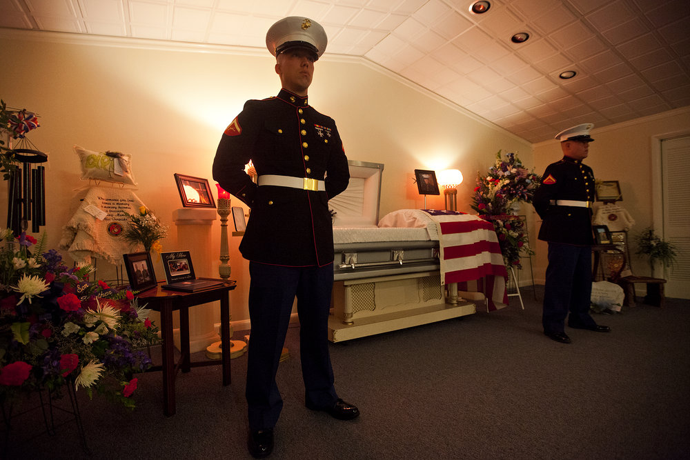 Lance Cpl. Ben Knies, left, and Lance Cpl. Nathan Schroering, both high school friends of Lance Cpl. Alec Terwiske, were the first two Marine sentries posed in front of Terwiske's casket at the Becher-Kluesner North Chapel funeral home the evening Terwiske's body was first returned to the county. A different sentry was posted each hour overnight and two stood guard throughout the visitation.