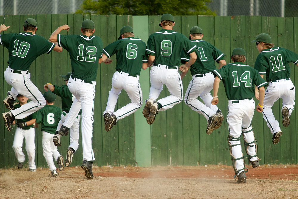 Several members of the Forest Park varsity baseball team hopped and clicked their heals together as they ran in between innings during the Class 2A baseball sectional against Tell City at League Stadium in Huntingburg.