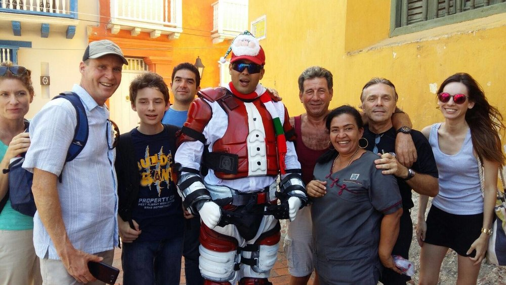 Friends from Nueva Lengua participating with Cartagena police in a Christmas charity event for local children.