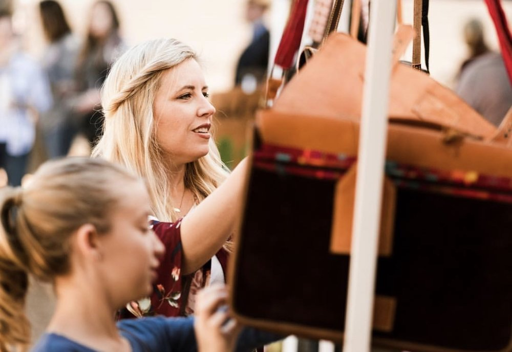 The hunt for the perfect bag at Boho Saint Jo!