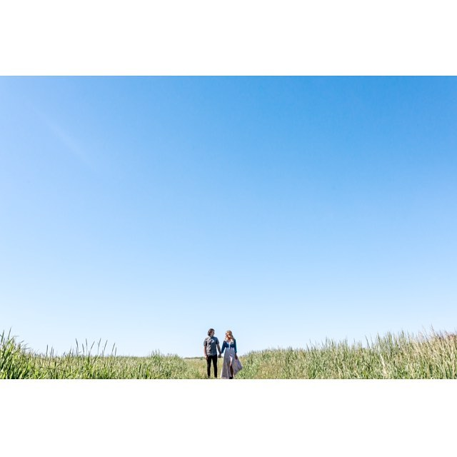 There's something about tiny humans in a vast landscape. However, on the contrary, these humans aren't so tiny 😂. #Throwback #Summer #blueskies #love #engagementshoot #engaged #minimalist #minimalist #negativespace #makeportraits #passionpassport