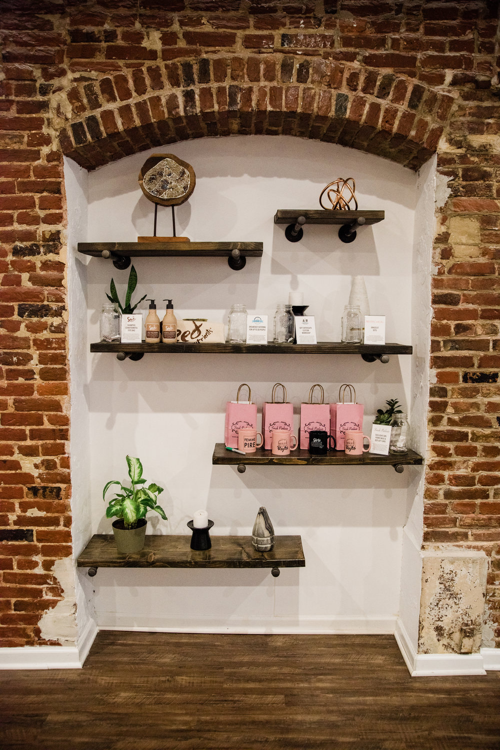 This cute little nook at TORC hosted all of our giveaways. Each attendee was given 5 raffle tickets upon entering the party and they placed their tickets in the jars of their favorite items. || Photo by  Julia Dent Photography