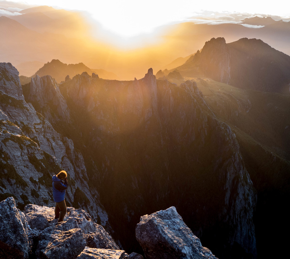 Dan Haley, capturing the sunset from the summit of Federation Peak, looking towards the Eastern Arthurs skyline.