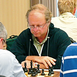 FIDE Master & LOCAL CHESS COACH Alex Zelner, who founded the Orlando Chess & Games Center.