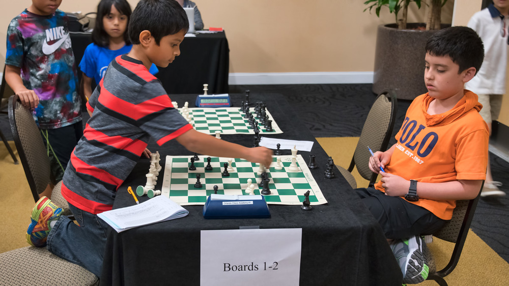Final Round, Board 1, Scholastic Section, Amit P. (1056) (L) vs Juan Pablo Flores C. (493 P10) (R) Where Amit would go on to sweep the Section with a 5-0 score. Great Job Amit!